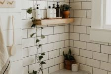 place some greenery in pots on the open shelves to make your neutral bathroom feel and look very fresh