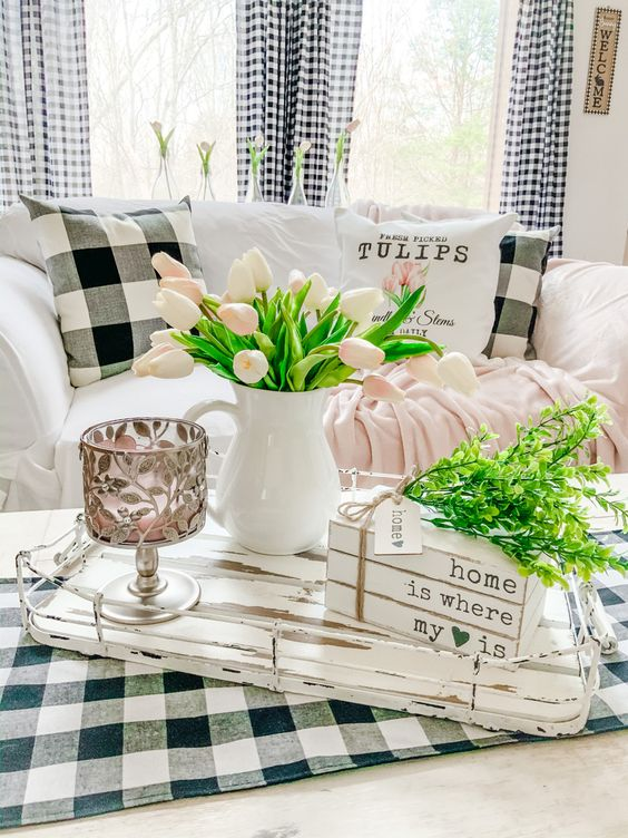 refresh your monochromatic living room with pink blooms, greenery and pink linens and make it feel like spring
