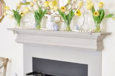 simple Easter mantel styling with yellow tulips, wooden ebads and fake blue eggs and a bunny