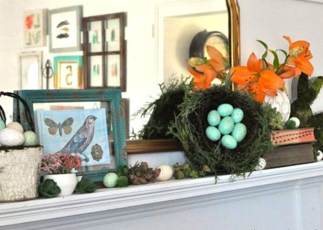 simple Easter mantel with faux eggs, a fake nest, some bird pictures and moss