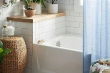 some potted greenery and a little lemon tree to accent the neutral bathroom and wicker and wood for a warm touch