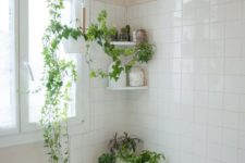 some wall shelves and suspended planters with greenery make the neutral bathroom feel and look very fresh