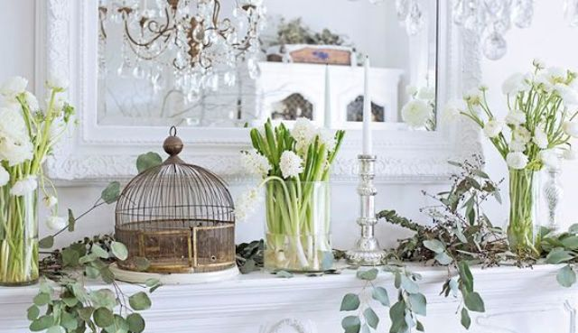 white bloom arrangements in clear vases, bird cages, fresh greenery and elegant candles