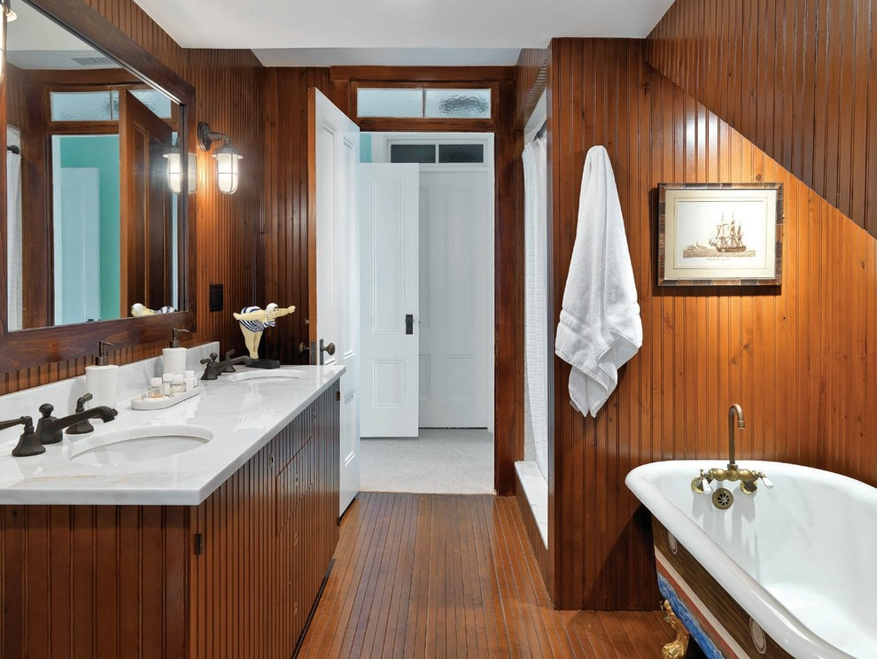 Dark wood is a great material if you're looking for not too modern bathroom's look.