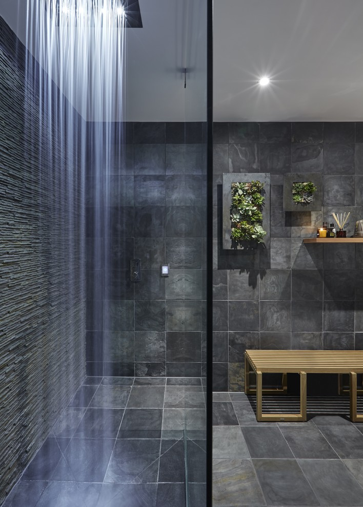 Dark wall-to-wall slate tiles are great but living wall foliage could make the bathroom's design truly impressive.