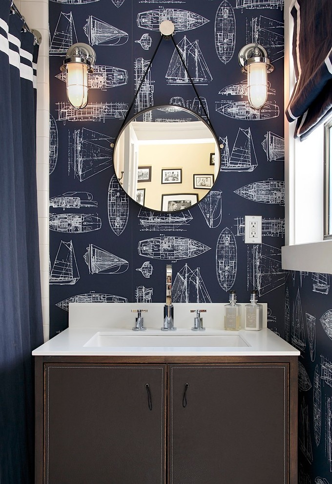 A creative wallpaper could work miracles even for masculine bathrooms.