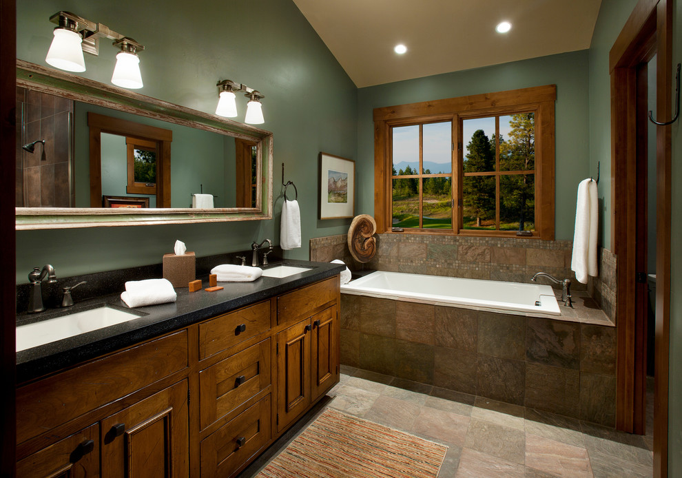 deep green and relatively dark wood is a great alternative to black and grey color schemes - Bathroom Designs And Colours
