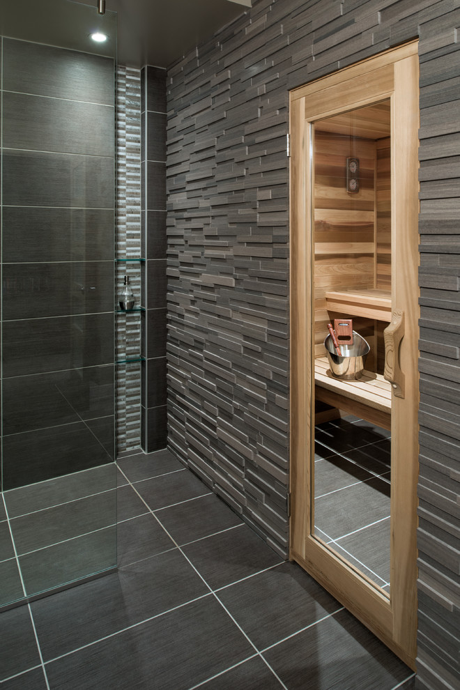 What could be more masculine than a super dark bathroom with a door to a wooden sauna? Nothing!