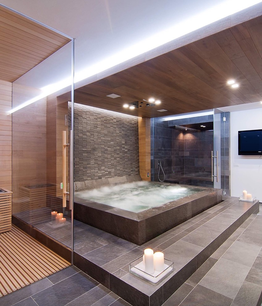 An indoor spa is a lovely addition to any bathroom, especially masculine one.