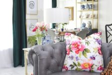 a bright floral print pillow and fresh blooms in a vase make the home office feel fresh and airy