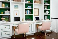 a brigth green wall and pink chairs plus gold touches add fun and brightness to the home office