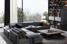 a contemporary dark living room with a large storage unit, an L-shaped sofa, a rug, a wooden coffee table and curtains