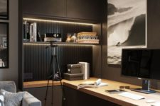 a contemporary moody home office with closed and open storage units, built-in lights, a large desk and upholstered chairs