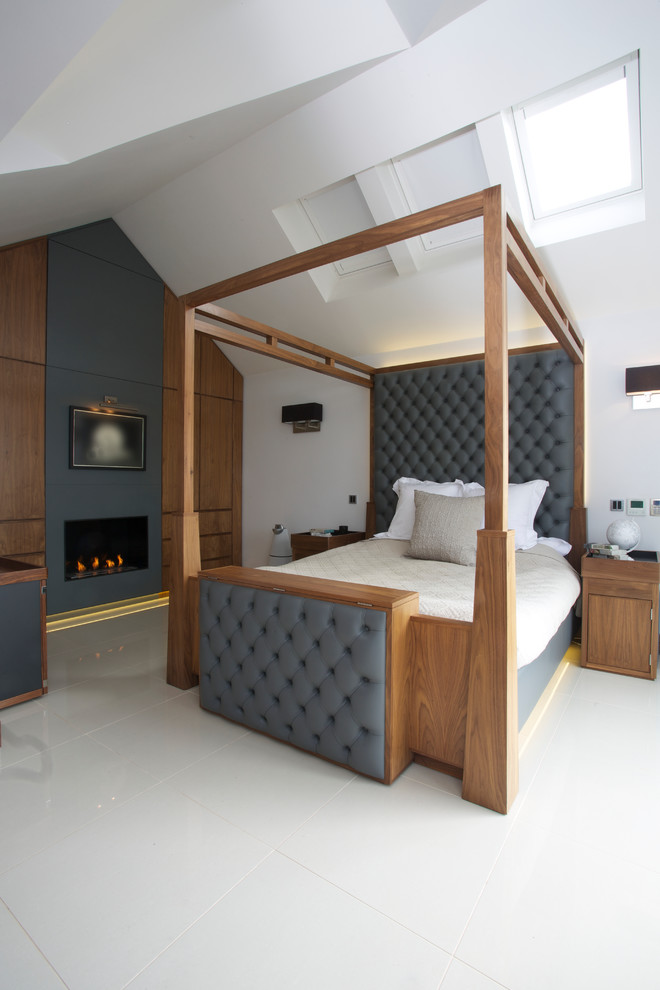 a fireplace and an unqiue wooden bed make this bedroom quite amazing