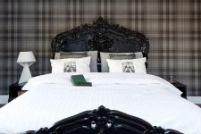 a high-gloss black lacquered bed and plaid wallpaper might look quite masculine