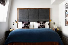 a large upholstered headboard could easily set a tone in a compact bedroom