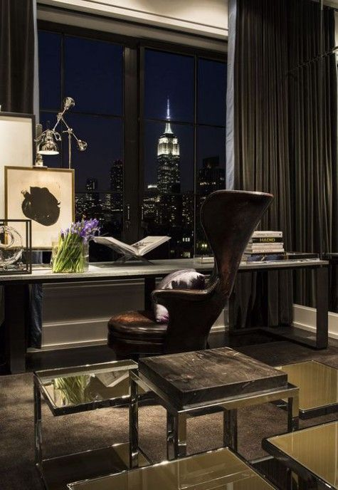 a luxurious home office with a large desk, a leather chair, a stone stool, a gorgeous view and glass side tables