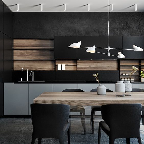 a minimalist kitchen in black, grey and with light-colored wood is very stylish and bold