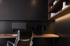 a minimalist masculine home office  with an open shelving unit with lights, a floating desk, sleek black cabinets for storage