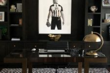 a modenr moody masculine home office with blakc built-in shelves, a dark stained desk, a sport-themed artwork plus shiny metal accents