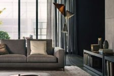 a stylish living room with neutral upholstery and a rug, floor lamps, a wooden coffee table and a storage unit