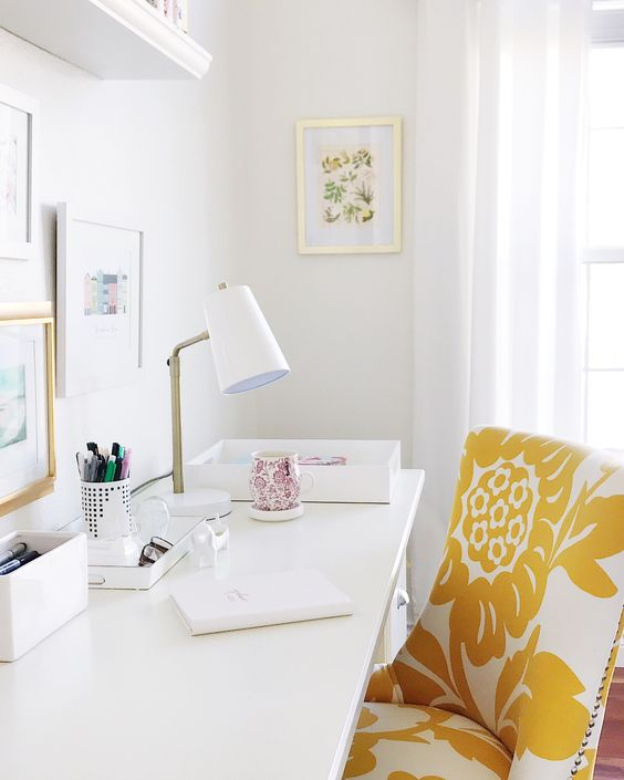 a yellow and white floral chair will add color and print to the spring home office easily