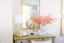 blooming branches in a chic vase will make yoru workspace look very chic, refined and very spring-like