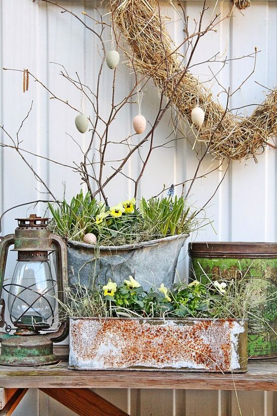 chic front Porch Easter decor with an Easter egg tree, potted blooms and a vintage lantern
