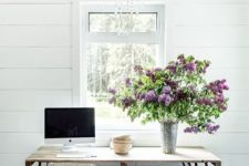 floral branches in a metal vase will bring a spring and a rustic feel to the home office or any other space