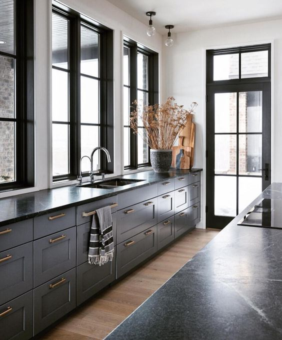 grey furniture with black countertops and gold handles for a timelessly elegant vintage look