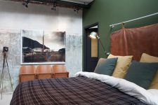 industrial bedroom with a cool headboard and a green wall