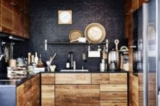 light-colored wooden cabinets with black metal countertops and blakc tile backsplashes for a contrasting look