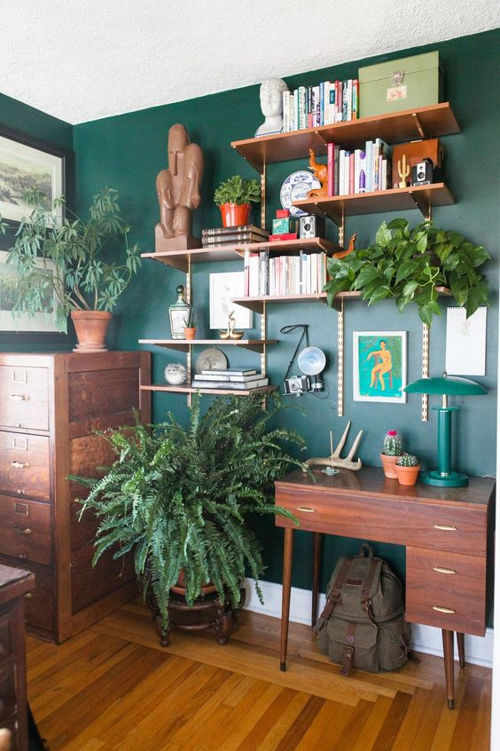 lots of potted greenery and a green wall make the home office bright, fresh and spring-like