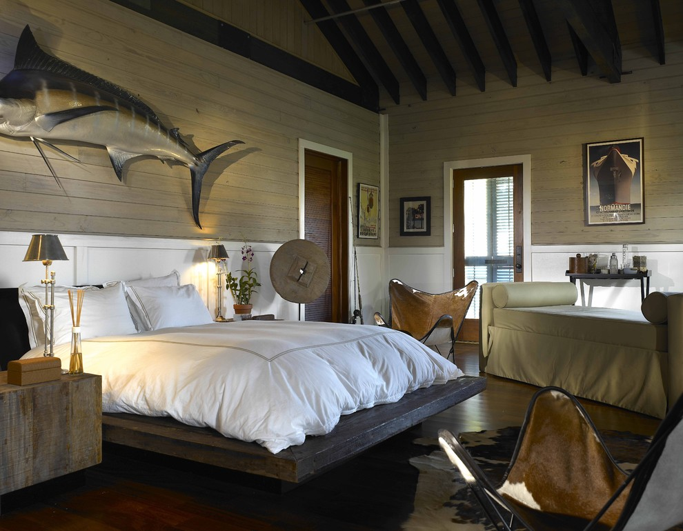 mid sized eclectic master bedroom with dark hardwood floors and beige walls would become quite masculine if you use right wall decor