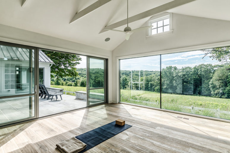 a minimalist glazed meditation space with a mat feels very airy and light-filled  (Blansfield Builders, Inc.)