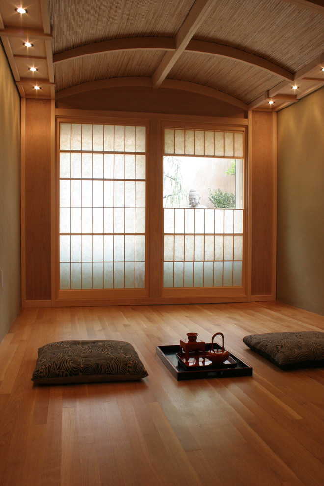 an Asian-inspired meditation room with pillows and lights  (Design A)
