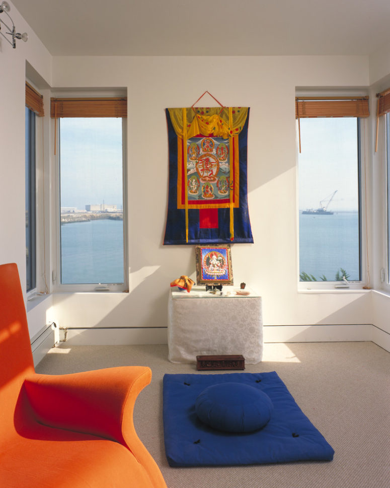 a colorful yet minimalist meditation space in orange and blue plus sea views (DNM Architecture)