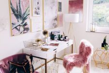 a bright and chic girlish home office with a pink fur chair, a purple chair and a pink and purple gallery wall