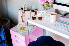 a bright and fun girlish home office with a navy stool, a hot pink cabinet, a bright printed rug and more pink touches