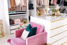 a bright and glam closet with an open storage unit and drawers, a white cabinet for storage, a hot pink chair and other hot pink touches