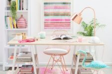 a bright feminine home office with a striped artwork, a colorful rug, a blue flamingo and touches of copper here and there