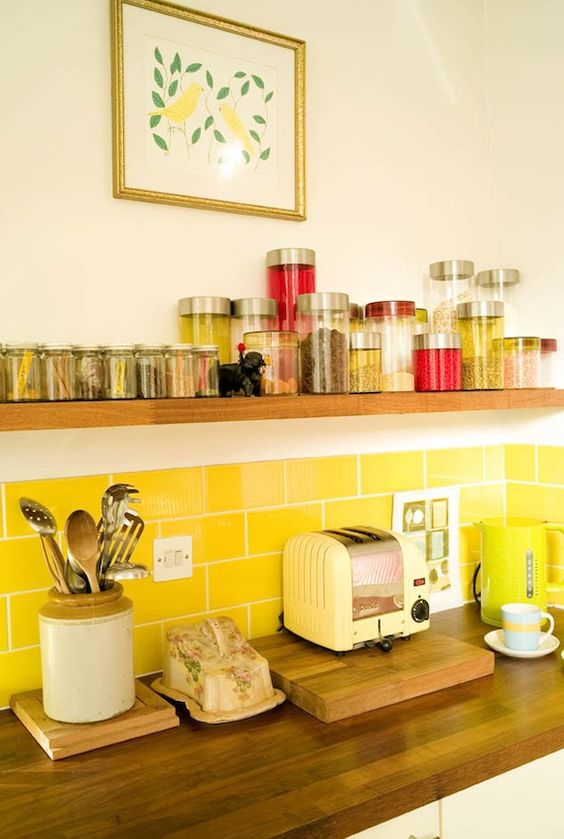 a bright yellow subway tile backsplash is a cool and sunny touch to your neutral kitchen is a very lovely idea
