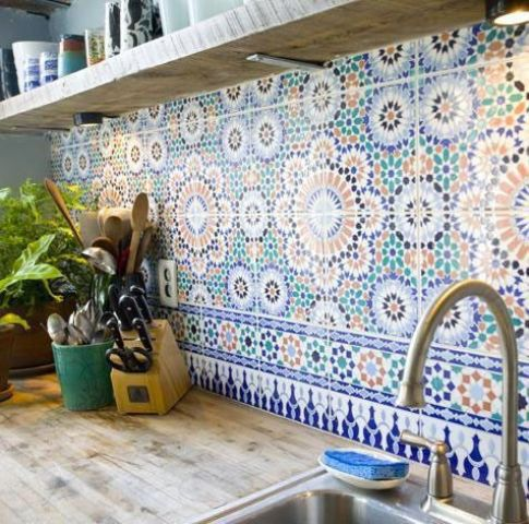 a colorful and patterned tile backsplash done in green, rust and navy is a lovely idea for a modern and neutral space