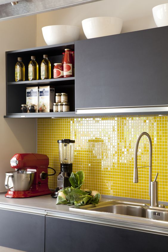 a sleek grey modern kitchen with grey countertops and a bold yellow small tile backsplash is a very cool and fresh idea