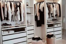 a small and glam closet with open storage units, drawers, mirrors and a pink pouf is a lovely idea for a modern home