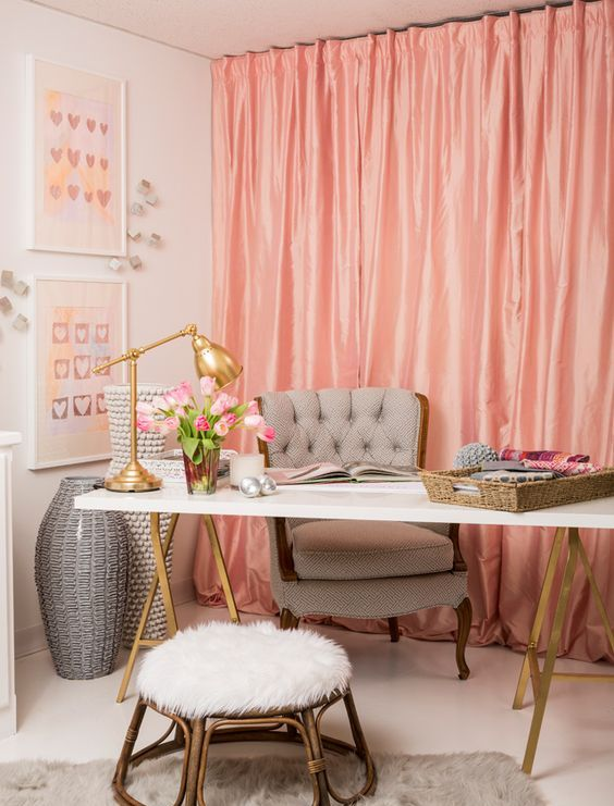 a stylish feminine home office with pink curtains, a trestle desk and refned chairs and stols plus gold touches