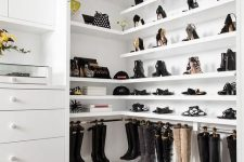 an elegant neutral closet with open shoe and bag shelves, with closed storage, a black faux fur stool and more black touches