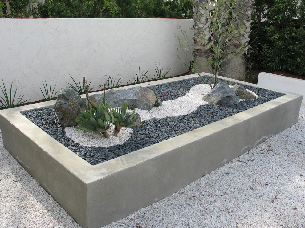 in sunny areas you could use succulents for a desert zen garden