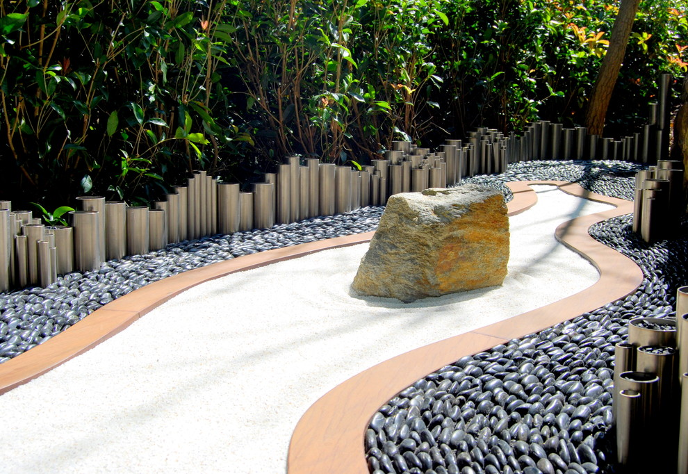 small zen garden if you rake the sand over after their play session