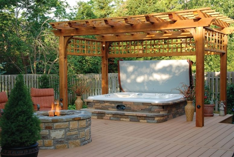 A hot spring spa surrounded covered natural stone is a beautiful addition to your outdoor space. (Hot Spring Spas)